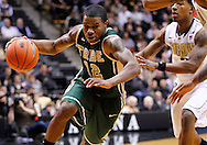 WEST LAFAYETTE, IN - DECEMBER 29: Brandon Britt #12 of the William & Mary Tribe dribbles the ball to the basket against the Purdue Boilermakers at Mackey Arena on December 29, 2012 in West Lafayette, Indiana. Purdue defeated William & Mary 73-66. (Photo by Michael Hickey/Getty Images) *** Local Caption *** Brandon Britt