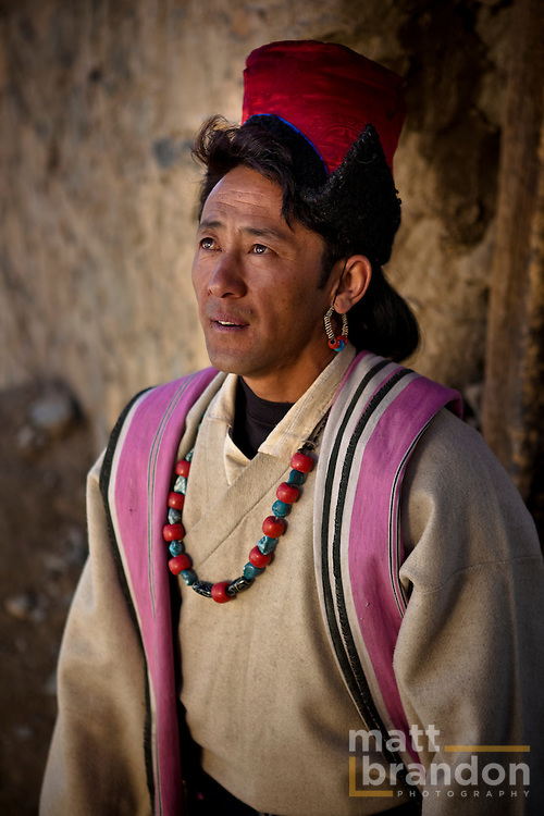 A Ladakhi man in traditional clothing with the familiar hat that is found only in Ladakh.