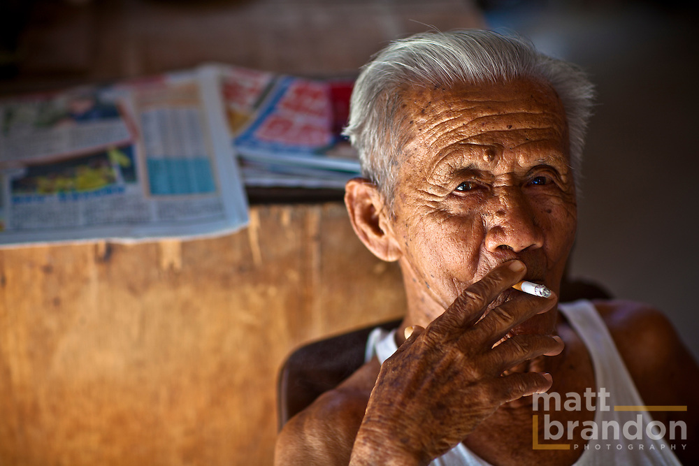 The old Chinese caretaker of the  long forgotten Majestic Theatre on Jalan Phee Choon. Takes a break to smoke a cigarette.
