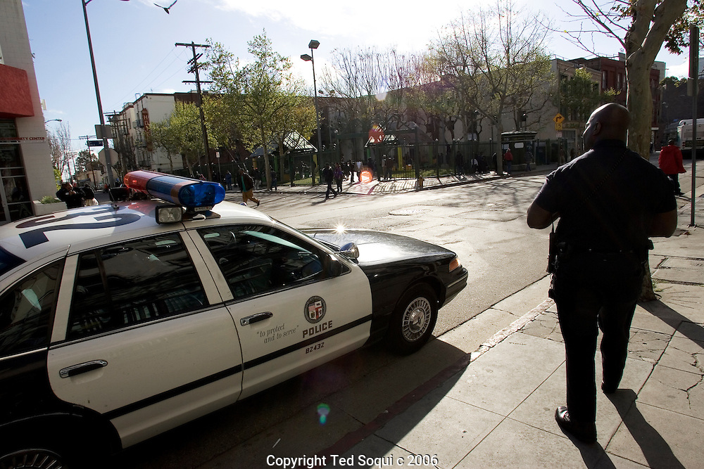 LAPD Senior Lead Officer Deon Joseph watches a park that has been infested by drug dealers and gang members. The park is in the middle of Downtown Los Angeles's skid row.