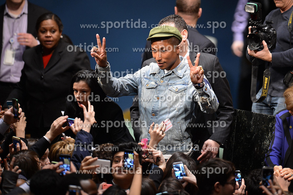 Singer Pharrell Williams poses to fans during an event marking the International Day of Happiness at the UN headquarters in New York, on March 20, 2015. Grammy-winning singer Pharrell Williams joined the United Nations to celebrate the International Day of Happiness on Friday, with an emphasis on reaching out to young people and move them to take action on climate change. EXPA Pictures &copy; 2015, PhotoCredit: EXPA/ Photoshot/ Niu Xiaolei<br /> <br /> *****ATTENTION - for AUT, SLO, CRO, SRB, BIH, MAZ only*****