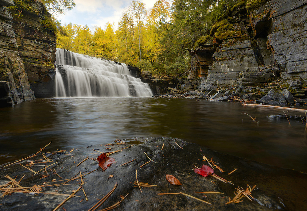 Autumn yellows make up the backdrop to Canyon Falls in Michigan's Upper Peninsula