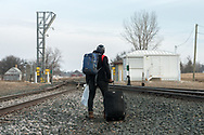 March 26, 2017 – Noyes, North Dakota : At the Canada-US border, a migrant from Ghana stops to rest, looking toward Canada where he plans to make an asylum claim.