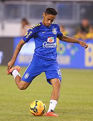 Sep 9, 2014; East Rutherford, NJ, USA; Brazil forward Neymar (10) takes a shot during warmups before their game against Ecuador at MetLife Stadium.