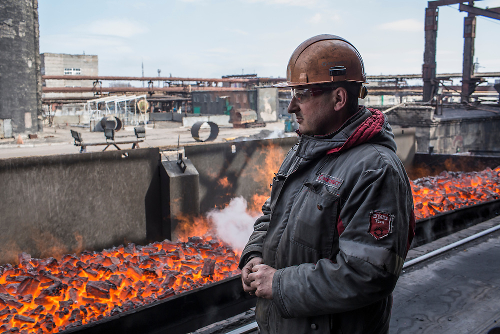 AVDIIVKA, UKRAINE - MARCH 18, 2015: A worker at the Avdiivka Coke and Steel plant watches as hot coke passes by fresh from the furnaces in Avdiivka, Ukraine. CREDIT: Brendan Hoffman for The New York Times