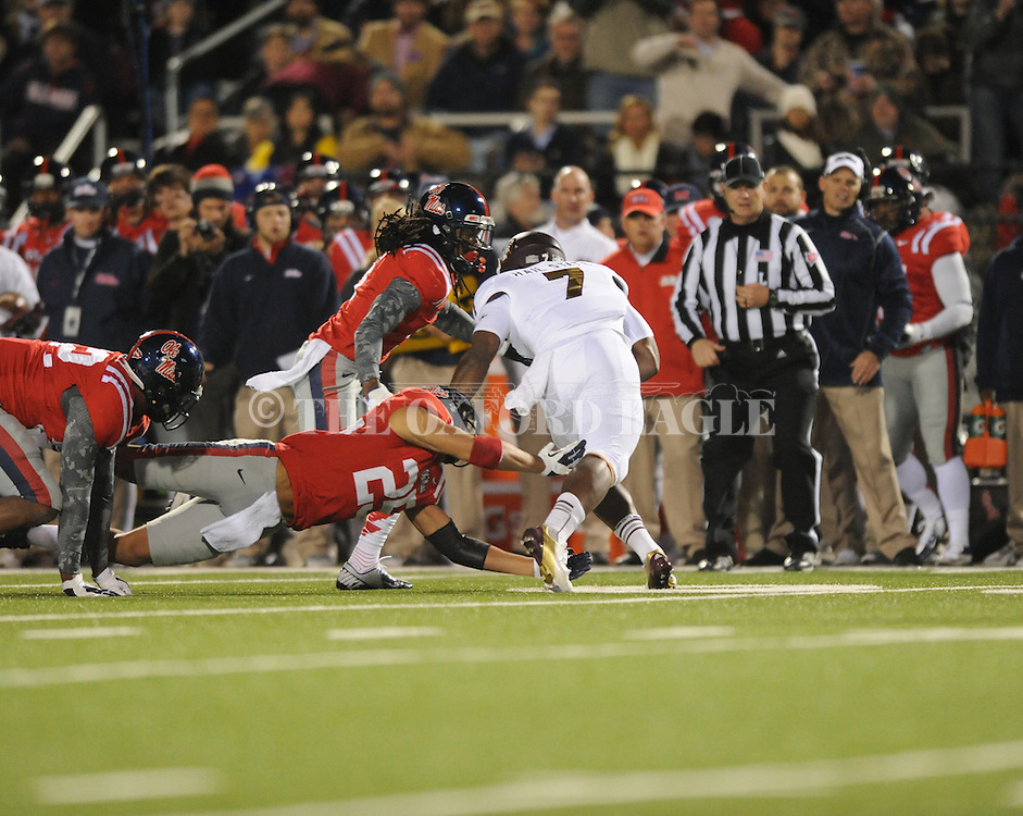 Ole Miss defensive back Charles Sawyer (3) and Ole Miss defensive back Cody Prewitt (25) tackle Mississippi State running back Nick Griffin (7) at Vaught Hemingway Stadium in Oxford, Miss. on Saturday, November 24, 2012. Ole Miss won 41-24.
