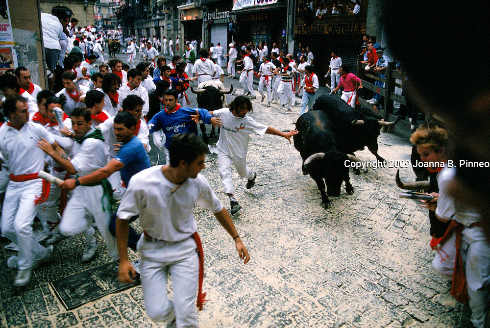 """""""Encierro""""  Pamplona Every morning for 7 days, at 8 am, 6 bulls run through the streets at the famous festival of San Fermin in Pamplona. The festival at San Fermin was made famous by Ernest Hemingway in his book Fiesta.   Despite it's popularity, the festival remains uniquely  a Basque tradition with all ages and family members attending."""