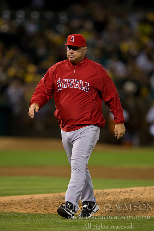 OAKLAND, CA - SEPTEMBER 23:  Mike Scioscia #14 of the Los Angeles Angels of Anaheim returns to the dugout after making a pitching change against the Oakland Athletics during the sixth inning at O.co Coliseum on September 23, 2014 in Oakland, California. The Los Angeles Angels of Anaheim defeated the Oakland Athletics 2-0.  (Photo by Jason O. Watson/Getty Images) *** Local Caption *** Mike Scioscia
