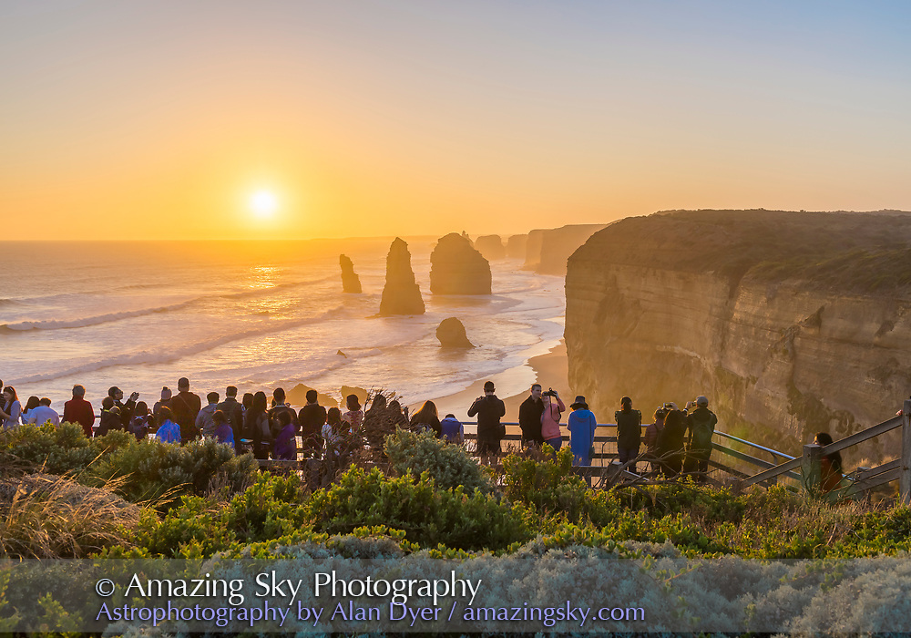 Tourists watching and photographing the sunset at the first and main Twelve Apostles viewpoint, on the Great Ocean Road, Australia.<br /> <br /> This is a 7-exposure HDR stack to compress the dynamic range from bright sky and dark ground. Merged in Adobe Camera Raw.