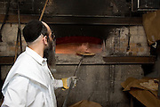 Israel, Tel Aviv, Baking Matzah. In order for the matza to be Kosher strict baking procedures must be followed, All hand made and under a strict watch of the Rabbi April 2005