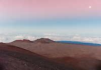 Moon rising over the top of Mauna Kea volcano in Hawaii, United States