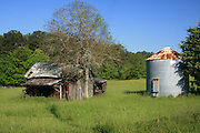 Abandoned tobacco shed and silo in the Georgia countryside