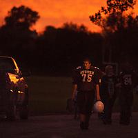An Auburn high school freshman leaves the field after a loss.