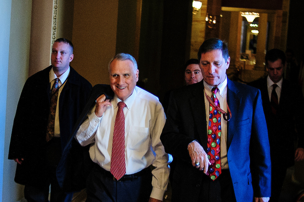 Senate Republican Whip Jon Kyle (R-AZ) is questioned by reporters as he returns from a meeting with Senate Minority Leader Mitch McConnell at the  U.S. Capitol on Sunday. Fiscal cliff negotiations continue at the U.S. Capitol in Washington, District of Columbia, U.S., on Sunday, Dec. 30, 2012. A combination of spending cuts and tax increases are set to kick in within hours unless congressional Republicans and Democrats cut a last-minute deal. Photographer: Pete Marovich/Bloomberg