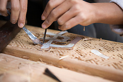 Vietnamese working on some wood decoration. Craft village of Dong Ky, specialized in wood furnitures manufacture. Vietnam, Asia