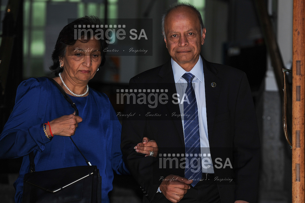 CAPE TOWN, SOUTH AFRICA - Tuesday 14 October 2014, Snila and Prakash Dewani, parents of Shrien Dewani, leave the court during Day 5 of the Shrien Dewani trial at the Western Cape High Court before Judge Jeanette Traverso. Dewani is caused of hiring hit men to murder his wife, Anni. Anni Ninna Dewani (n&eacute;e Hindocha; 12 March 1982 &ndash; 13 November 2010) was a Swedish woman who, while on her honeymoon in South Africa, was kidnapped and then murdered in Gugulethu township near Cape Town on 13 November 2010 (wikipedia).<br /> Photo by Roger Sedres