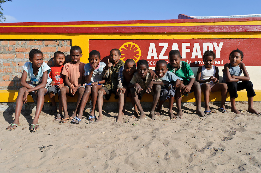Children outside the Azafady office, Fort Dauphin, Madagascar. Azafady's mission is to alleviate extreme poverty and protect endangered, biologically rich forest environments in Madagascar by empowering some of the poorest people to establish sustainable livelihoods and improve their health and wellbeing. Their aims are to raise awareness about the plight of the Madagascan environment and the Malagasy people; to empower Malagasy people to improve their own lives; and provide support to communities and threatened environments. Azafady's approach is one of co-operation and participation with grassroots communities working to alleviate the effects of poverty and to support viable, environmentally sensitive development. Their holistic development and conservation projects support some of the world's most vulnerable people in threatened & irreplaceable environments. At the heart of the charity's work is an integrated approach to the needs of the Malagasy people and their unique environment, sensitively built around what local people have told the charity are their most critical needs and which maximises community participation. Azafady develop projects using the Sustainable Livelihoods model for poverty reduction, which aims to reduce vulnerability by strengthening communities' human, natural, financial, social and physical assets with a caveat that the charity's projects and activities do not compromise the environment. Projects incorporate communication, training and support at the level of the Fokontany (village) and the household, with a priority for the most isolated and marginalised communities. The charity has recently recruited a Research, Monitoring and Evaluation Manager, who will implement Azafady's new HIV/AIDS activities with pregnant and married women, with the aim of reducing rates of maternal transmission of HIV within the town.