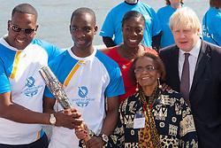London, June 6th 2014. Mayor of London Boris Johnson joins Olympic and Commonwealth champion Christine Ohuruogu MBE and batonbearers Faramolu Johnson and Michael Pusey to welcome the Commonwealth Games Queen's Baton Relay to the Capital.