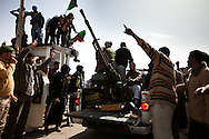 Volunteer troops race to drive out an army force loyal to Qadaffi in the town of Brega on March 2, 2011.