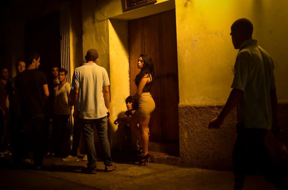 A woman surrounded by foreign tourists stands outside of Club Elektra, a club where men go to pick up prostitutes in the historic district in Cartagena, Colombia.  A sex scandal erupted recently when secret service agents were found bringing prostitutes to their hotel rooms while in Cartagena preparing for President Barack Obama's arrival to the Summit of the Americas.