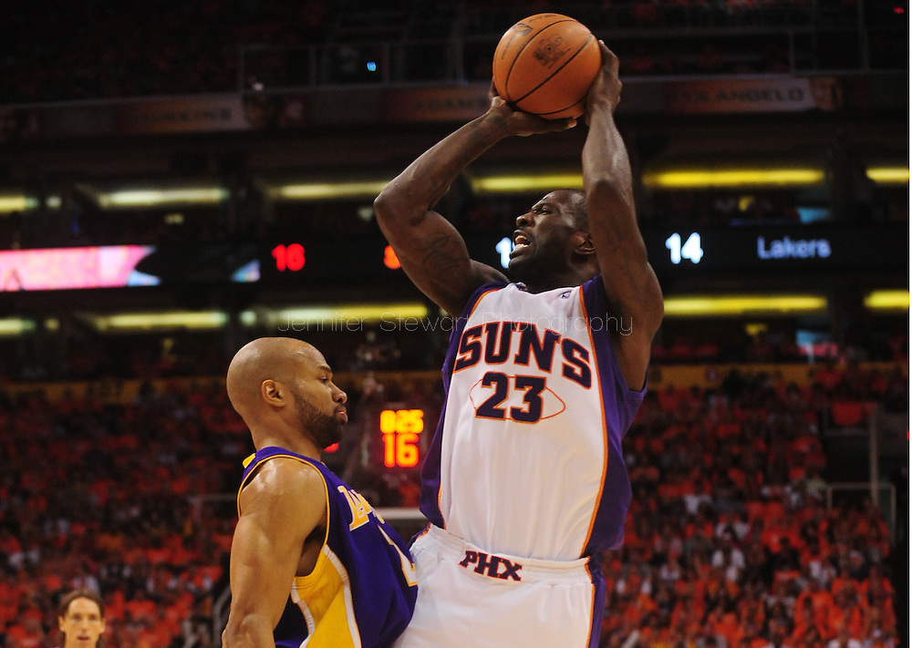 May 29, 2010; Phoenix, AZ, USA; Phoenix Suns guard Jason Richardson (23) puts up a shot against Los Angeles Lakers guard Derek Fisher (2) during the first quarter in game six of the western conference finals in the 2010 NBA Playoffs at US Airways Center.  Mandatory Credit: Jennifer Stewart-US PRESSWIRE