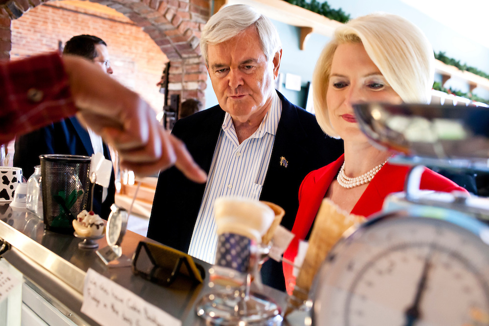 Republican presidential candidate Newt Gingrich and his wife Callista Gingrich buy ice cream after a campaign meet and greet at Elly's Tea and Coffee on Tuesday, January 3, 2012 in Muscatine, IA.