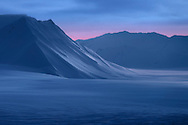 "After several months, the polar night has finally lost its grip on Svalbard. The ""blue season"" will last several weeks, before the first rays of Sun shine in this part of the world."