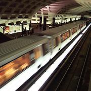 USA, Washington, DC. A train passes through a Metro station.