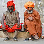 Men watching sunrise on the Ganges, Varanassi, India