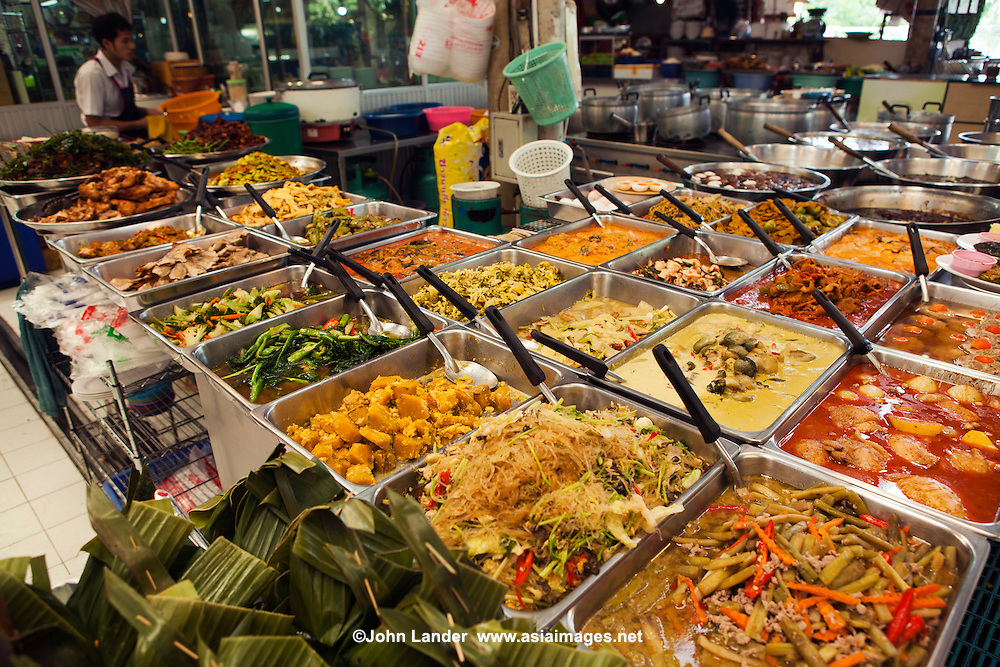 Thai curry refers to dishes in Thai cuisine that are made with various types of curry paste; the term can also refer to the pastes themselves. A Thai curry dish is made from curry paste, coconut milk or water, meat, seafood, vegetables or fruit, and herbs. Curries in Thailand mainly differ from the curries in Indian cuisine and other South Asian cuisines in their use of fresh ingredients such as herbs and aromatic leaves over a mix of spices
