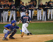Mississippi's Tim Ferguson scores vs. Florida's Hampton Tignor at Oxford-University Stadium on Saturday, March 27, 2010 in Oxford, Miss. Ole Miss won 15-3. Ferguson went 5-for-5.