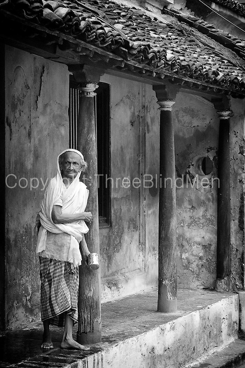 Woman standing outside her home in the old part of Nagapattinam town.