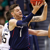 SOUTH BEND, IN - JANUARY 12: Enosch Wolf #1 of the Connecticut Huskies snags a rebound during action against the Notre Dame Fighting Irish at Purcel Pavilion on January 12, 2012 in South Bend, Indiana. (Photo by Michael Hickey/Getty Images) *** Local Caption *** Enosch Wolf