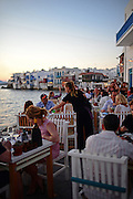 Cafe terrace with Little Venice in view, Mykonos, Greece