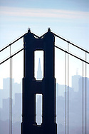The San Francisco skyline as seen through the Golden Gate Bridge.