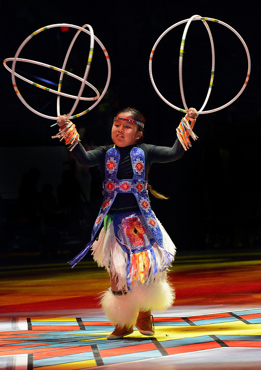 jt042817b/a sec/jim thompson/ Jayven Begaye-8 of Peoria, AZ does a hoop dance just before the start of the 2017 Gathering of Nations Pow-Pow held at Tingley Coliseum.   Friday April 28, 2017. (Jim Thompson/Albuquerque Journal)
