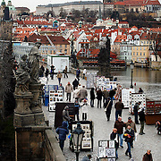 "SHOT 11/21/08 7:57:40 AM -  The Prague Castle (upper right) and Charles Bridge in Prague, Czech Republic. Prague Castle (Czech: Pra?ský hrad) is a castle in Prague where the Czech kings, Holy Roman Emperors and presidents of Czechoslovakia and the Czech Republic have had their offices. The Czech Crown Jewels are kept here. Prague Castle is one of the biggest castles in the world (according to Guinness Book of Records the biggest ancient castle) at about 570 meters in length and an average of about 130 meters wide. Charles Bridge is a famous historical bridge that crosses the Vltava river in Prague, Czech Republic. The bridge is 516 meters long and nearly 10 meters wide, resting on 16 arches shielded by ice guards. It is protected by three bridge towers, two of them on the Lesser Quarter side and the third one on the Old Town side. The Old Town bridge tower is often considered to be one of the most astonishing civil gothic-style buildings in the world. The bridge is decorated by a continuous alley of 30 statues and statuaries, most of them baroque-style, erected around 1700. Prague is the capital and largest city of the Czech Republic. Its official name is Hlavní m?sto Praha, meaning Prague, the Capital City. Situated on the River Vltava in central Bohemia, Prague has been the political, cultural, and economic centre of the Czech state for over 1100 years. The city proper is home to more than 1.2 million people, while its metropolitan area is estimated to have a population of over 1.9 million. Since 1992, the extensive historic centre of Prague has been included in the UNESCO list of World Heritage Sites. According to Guinness World Records, Prague Castle is the largest ancient castle in the world. Nicknames for Prague have included ""the mother of cities"", ""city of a hundred spires"" and ""the golden city"". Since the fall of the Iron Curtain, Prague has become one of Europe's (and the world's) most popular tourist destinations. It is the sixth most-visited European cit"