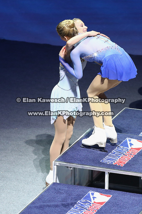 Polina Edmunds hugs Gracie Gold is seen during the awards ceremony following the championship ladies free skate competition at the 2014 US Figure Skating Championships at the TD Garden on January 11, 2014 in Boston, Massachusetts.