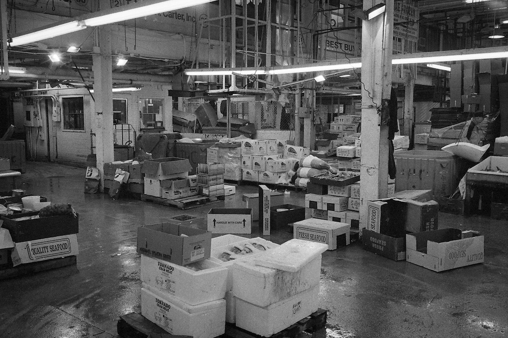 Many proprietors could be found in the market. Much like a semi enclosed flea market. The Fulton Street Fish Market operated in this location near the Brooklyn Bridge for 183 years until it was relocated to the Bronx in 2005.