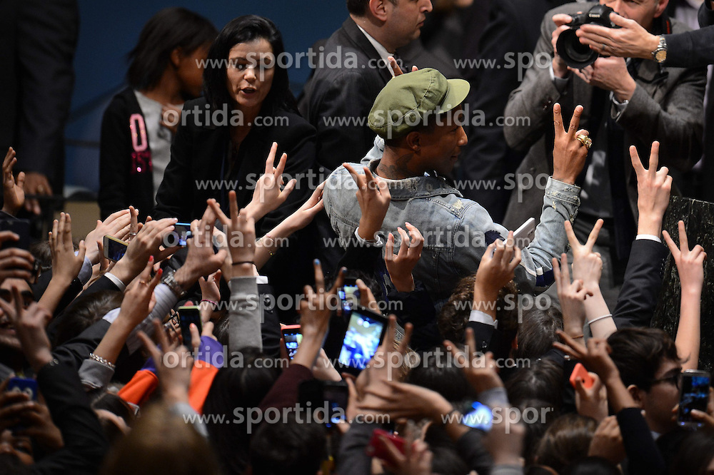 Singer Pharrell Williams (in green cap) poses for a picture with fans during an event marking the International Day of Happiness at the UN headquarters in New York, on March 20, 2015. Grammy-winning singer Pharrell Williams joined the United Nations to celebrate the International Day of Happiness on Friday, with an emphasis on reaching out to young people and move them to take action on climate change. EXPA Pictures &copy; 2015, PhotoCredit: EXPA/ Photoshot/ Niu Xiaolei<br /> <br /> *****ATTENTION - for AUT, SLO, CRO, SRB, BIH, MAZ only*****