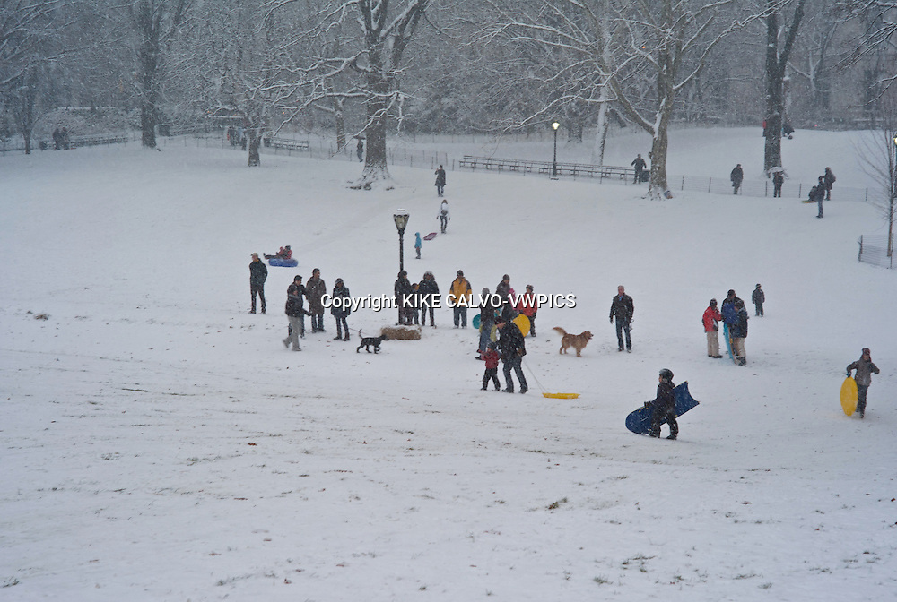 Snow blizzard in Central Park. Manhattan. New York City.Children playing on the snow