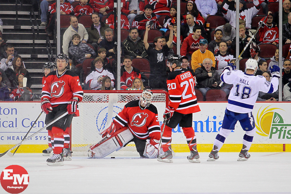 Feb 7, 2013; Newark, NJ, USA; New Jersey Devils goalie Martin Brodeur (30) reacts after giving up a goal to Tampa Bay Lightning center Nate Thompson (44) (not shown) during the second period at the Prudential Center.