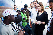 Libya: Actress and UNHCR goodwill ambassador Angelina Jolie visited IDP's at Tripoli's Janzur Port on Wednesday.<br /> <br /> On the last of a two day trip to Libya, Angelina spoke with displaced persons men and women from both Nigeria and Mali. They raised concerns about repatriation and the ability to legally remain in Libya as well as sharing the experiences of the conflict during the past several months and discussing the challenges that lay ahead.<br /> <br /> <br /> &copy;J Tanner 2011