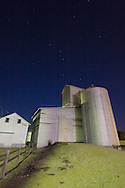 The constellation known as the Big Dipper is high in the sky over the small grain elevator in downtown Big Rock, IL.
