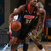 Springfield Armor Forward Devin Ebanks (23) dribbles the ball past Delaware 87ers Forward Thanasis Antetokounmpo (19) in the second half of a NBA D-league regular season basketball game between the Delaware 87ers (76ers) and Springfield Armor (Brooklyn Nets) Saturday, Apr. 05, 2014 at The Bob Carpenter Sports Convocation Center, Newark, DEL.