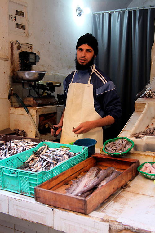 Africa, Morocco, Fes. Fish vendor in Fes souk.