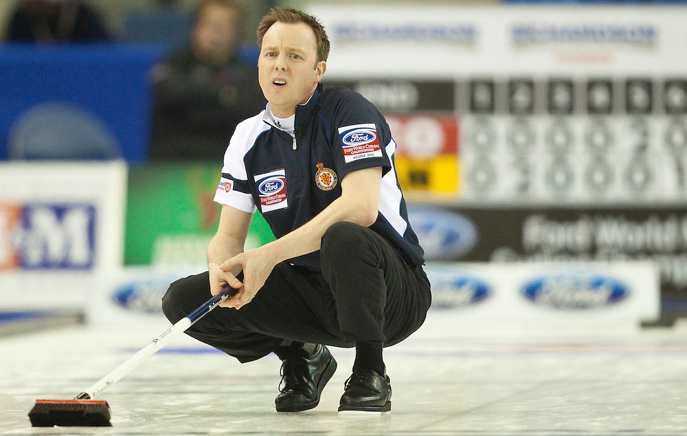 Scottish skip Tom Brewster reacts after missing a shot during Scotland's 5-2 loss to Canada in the 1-2 playoff match at the Ford World Men's Curling Championships in Regina, Saskatchewan, April 8, 2011.<br /> AFP PHOTO/Geoff Robins