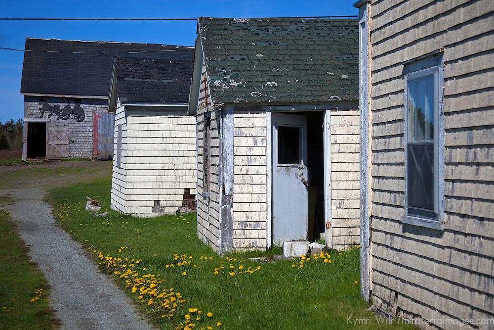 North America, Canada, Nova Scotia, Guysborough County.  Weathered homes and a barn in rural Guysborough.