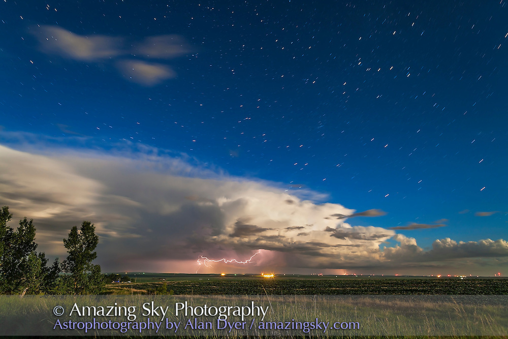 A thunderstorm moving across the northern horizon, lit by moonlight, and with the stars of Cassiopeia, Andromeda and Perseus rising. Shot June 25, 2013, using Canon 5D MkII at ISO 200 and 24mm lens at f/5 for 3 minute exposure. Shot from home.