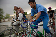Afghan Cycling Federation nation team rider Mohammed Karim Yaqoot, right, trains on the streets of Kabul, Afghanistan. The ACF's national cycling team  now has roughly 15 men, 15 juniors, and 10 women who have participated in local, regional, and international races including the Southeast Asian Games.